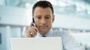 Insurance agent at computer