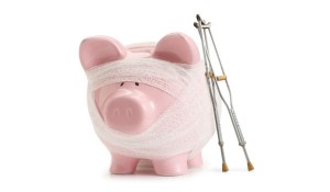 Piggy bank with bandage and crutches