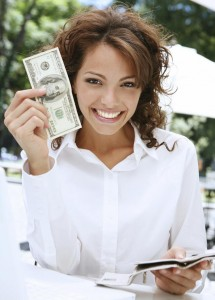 Woman holding a $100 bill